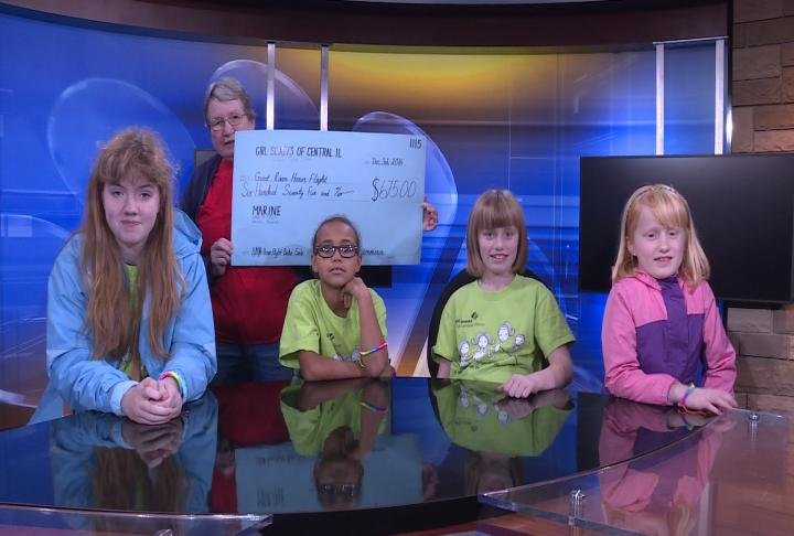 Girl Scouts of Central Illinois Troop 5144 from Hamilton presenting the check.