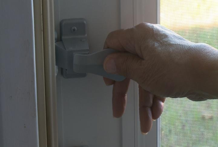 Homeowner shows off the door received through the grant program.