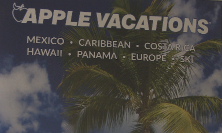 A vacation poster at Travel House of Quincy