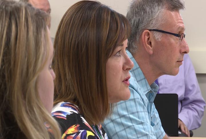 Administrators talk about district improvement plans.
