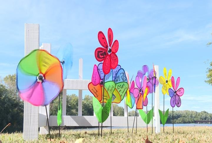 Pinwheels placed along the riverfront to honor children that have passed away