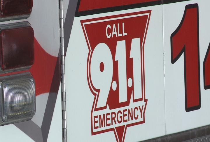 Call 911 sign placed on back of ambulance.