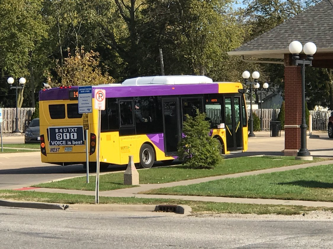 A bus making s stop in Macomb