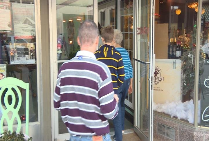 Shoppers browse in and out of stores in Downtown Hannibal.