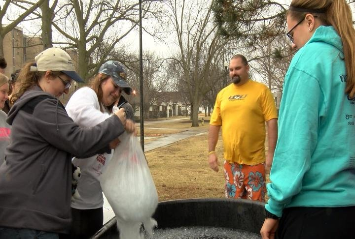 Students added more ice before QU Football Coach Gary Bass jumped in.
