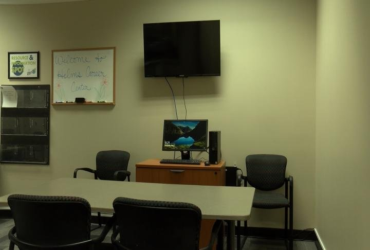 Training corner of the center with projectors and desks.