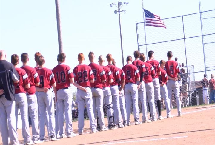 Team standing for national anthem before game