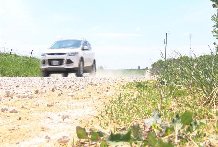 A car driving on a Marion County gravel road.