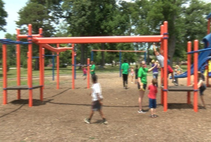 Kids playing on equipment in Madison Park