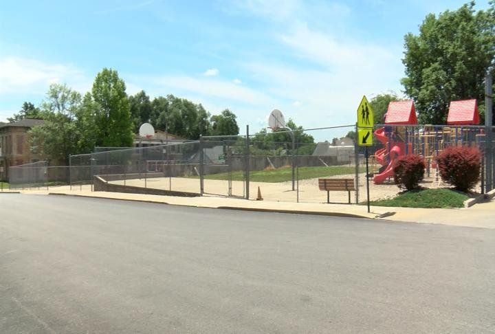 Holy Family's play ground is across Maple avenue from the school
