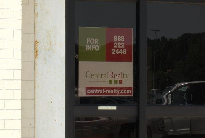 Signage of the real estate company selling the store.