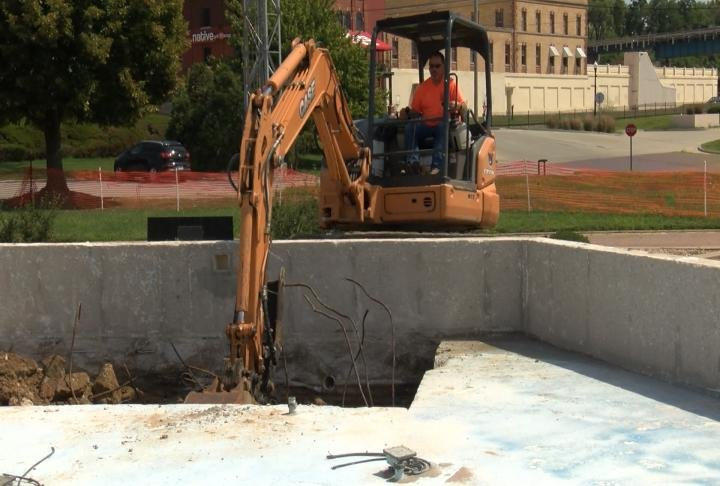 Crews doing demo work on the old fountain