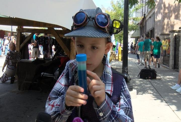 Morr, 8, showing off potion vials he made for his costume.