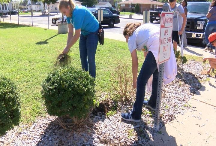 More than 160 8th graders helped pick up landscaping at the Macomb Police Department.