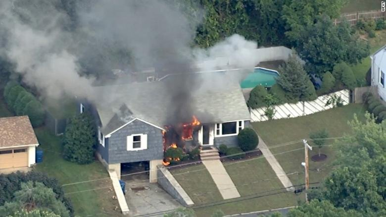 A home burns Thursday in Lawrence, Massachusetts.