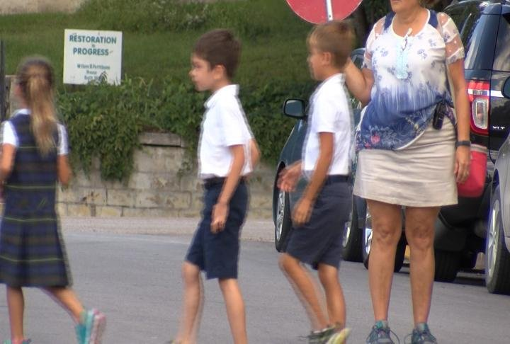 Students at the school have to cross the street to get to the playground/
