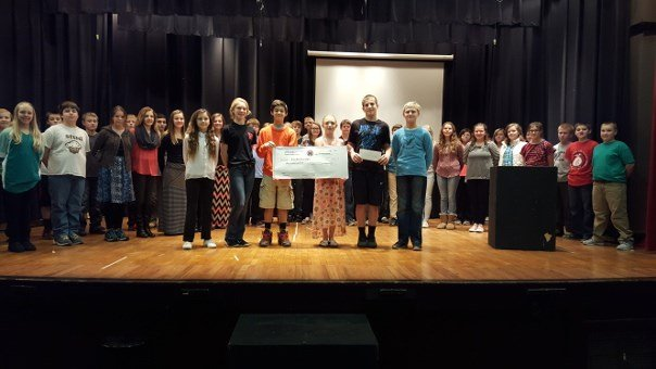Seventh graders stand with their donation to Great River Honor Flight.